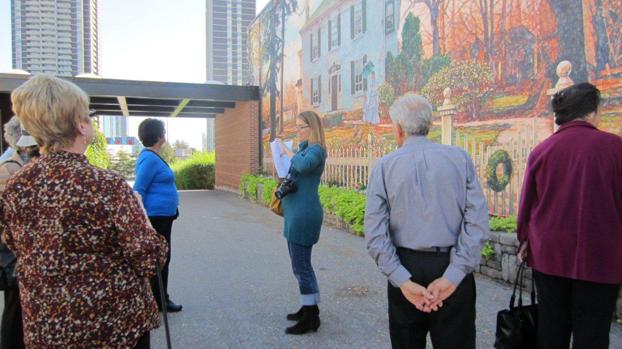Nathalie Prezeau in Action describing a mural along Dundas Street